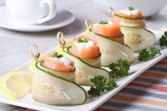 cucumber rolls with salmon, cream cheese closeup horizontal